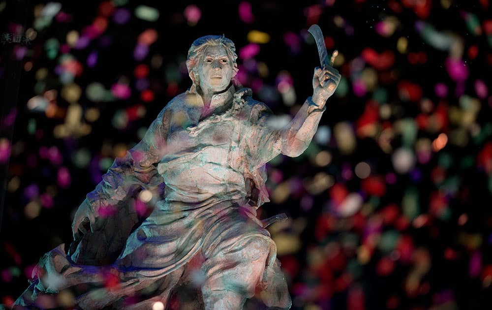 Confetti rains on the newly unveiled statue of Bolivian Juana Azurduy de Padilla, behind the government house in Buenos Aires, Argentina.