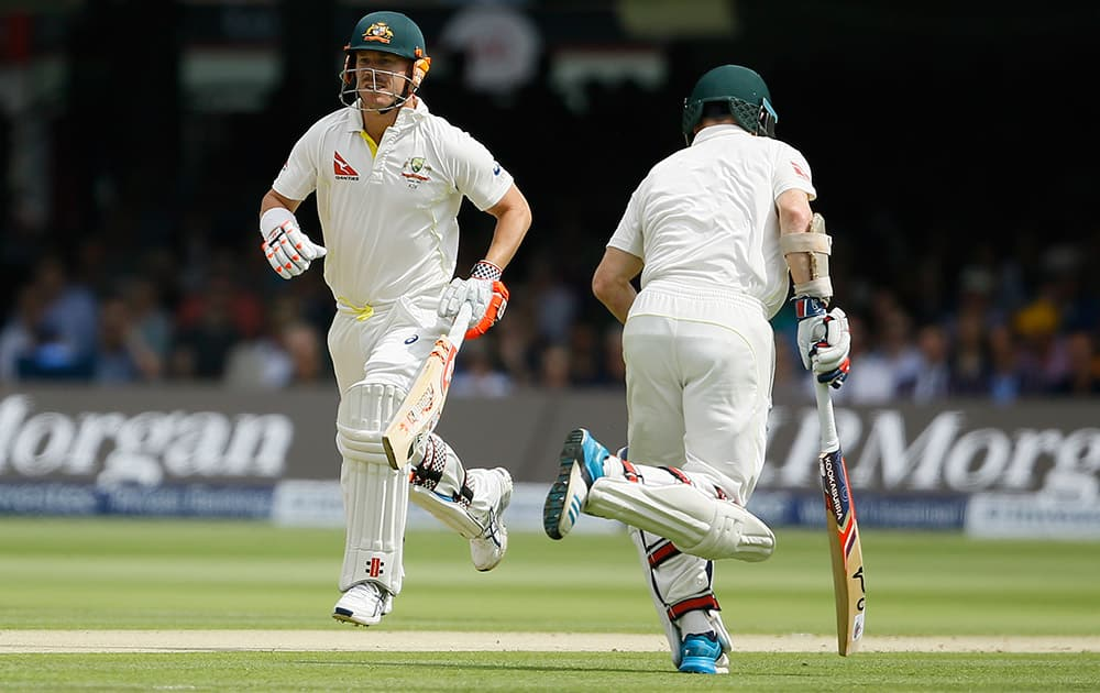 Australia's David Warner and Chris Rogers add runs on the first day of the second Ashes Test match between England and Australia, at Lord's cricket ground in London.