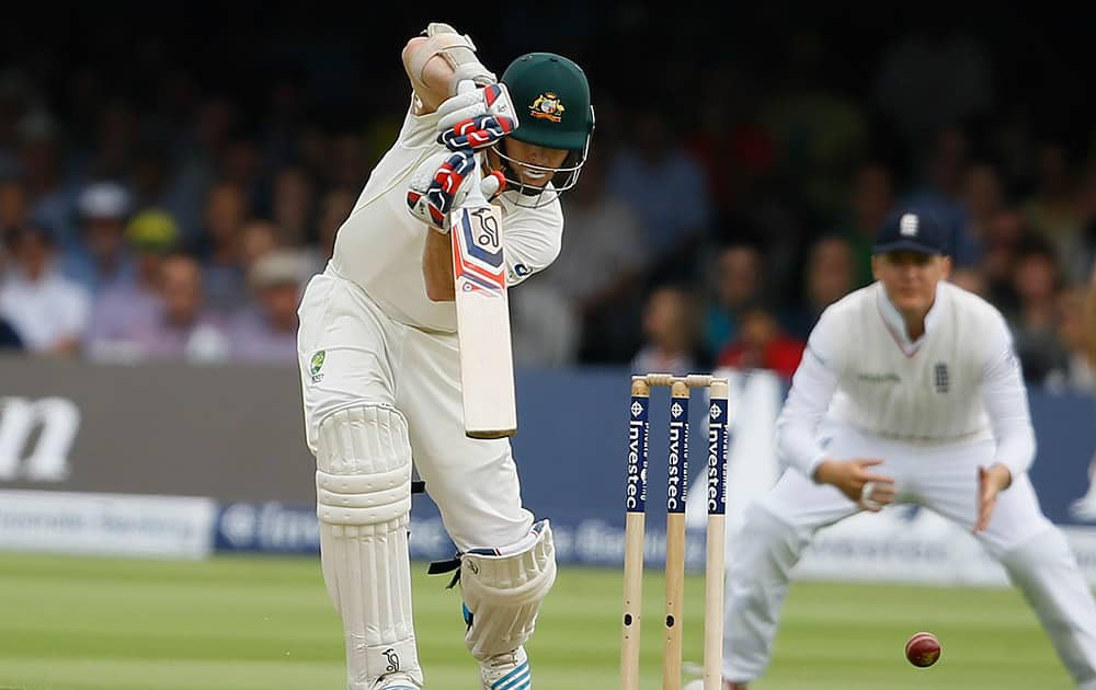 Australia's Chris Rogers plays a shot off the bowling of England's James Anderson on the first day of the second Ashes Test match between England and Australia, at Lord's cricket ground in London.
