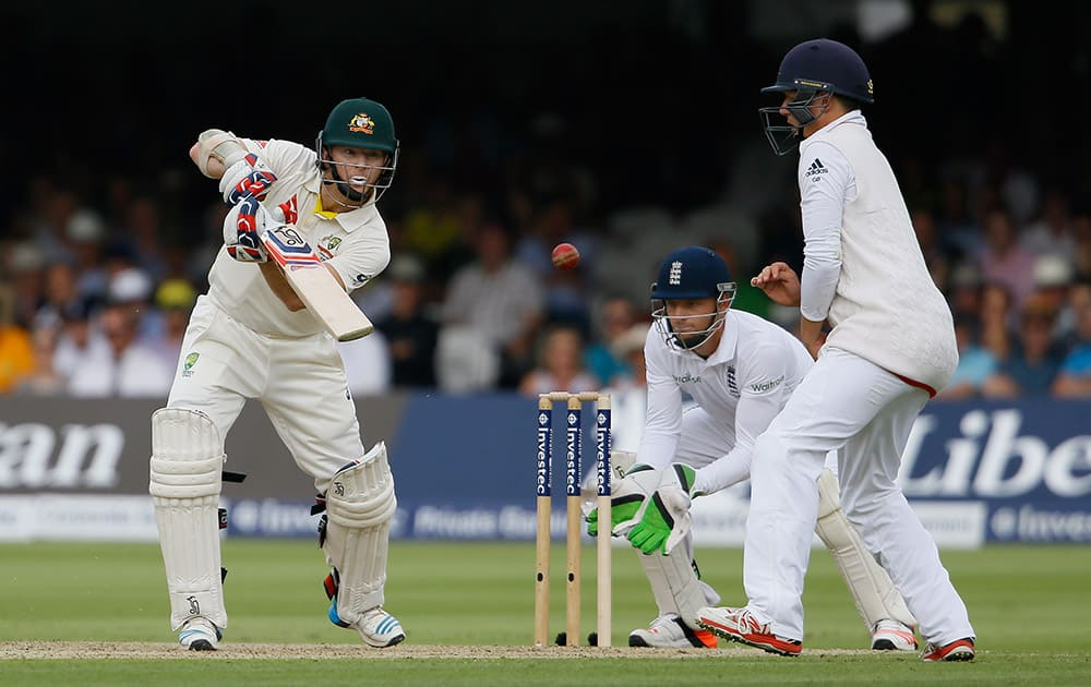 Australia's Chris Rogers plays a shot off the bowling of England's Joe Root on the first day of the second Ashes Test match between England and Australia, at Lord's cricket ground in London.