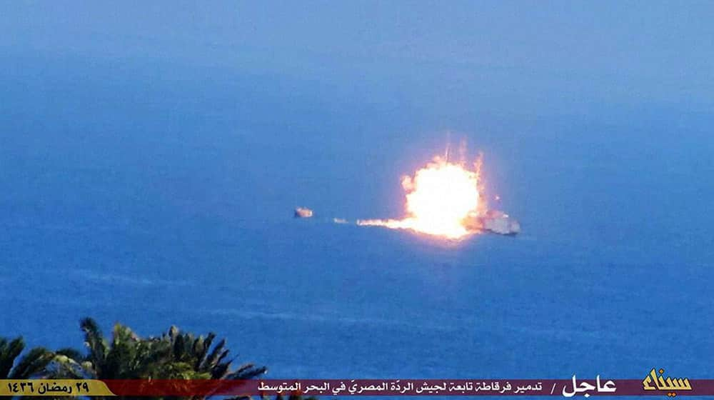 This image posted on a militant social media account affiliated with the Sinai branch of the Islamic State group, shows a fireball rising from an Egyptian Navy vessel during a rocket attack claimed by the group, off the strategic peninsulas Mediterranean coast.