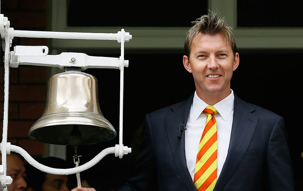 Former Australian cricket team player Brett Lee rings the bell to signify five minutes to the start of play on the second day of the second Ashes Test match between England and Australia, at Lord's cricket ground in London.