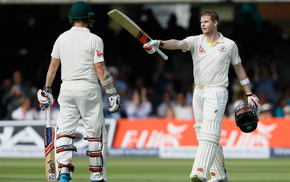 Australia's Steven Smith, celebrates with Chris Rogers after scoring a century on the first day of the second Ashes Test match between England and Australia, at Lord's cricket ground in London