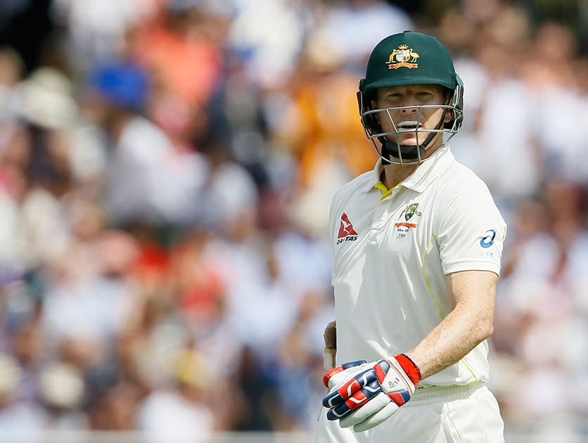 Australia's Chris Rogers leaves the pitch after being bowled by England's Stuart Broad on the second day of the second Ashes Test match between England and Australia, at Lord's cricket ground in London.