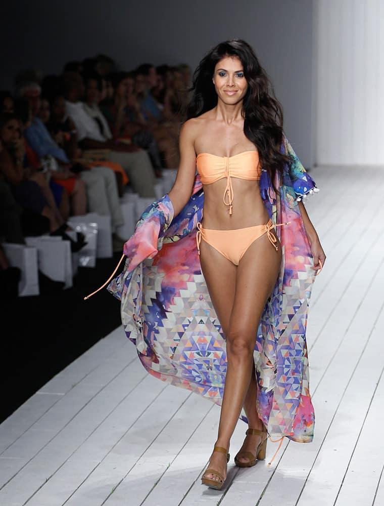 A model walks down the runway during the Robb & Lulu swimwear show as part of Funkshion Fashion Week Swim in Miami Beach, Fla.
