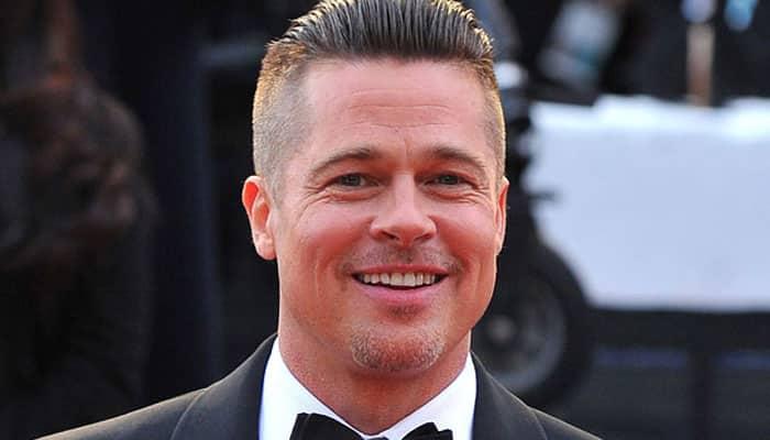 Brad Pitt unveils new family tattoo