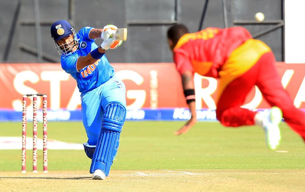 Robin Uthappa plays a shot during the Twenty20 cricket match against Zimbabwe in Harare, Zimbabwe.