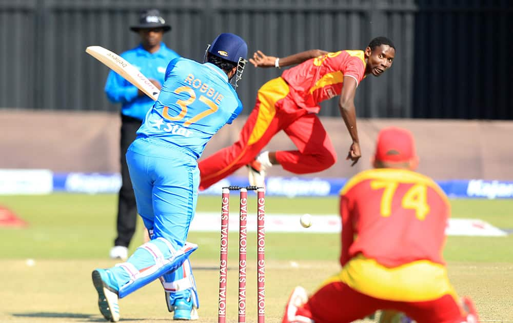 Zimbabwean bowler Christopher Mpofu bowls to Indian batsman Robin Uthappa on the first day of the Twenty20 cricket match against India in Harare, Zimbabwe.