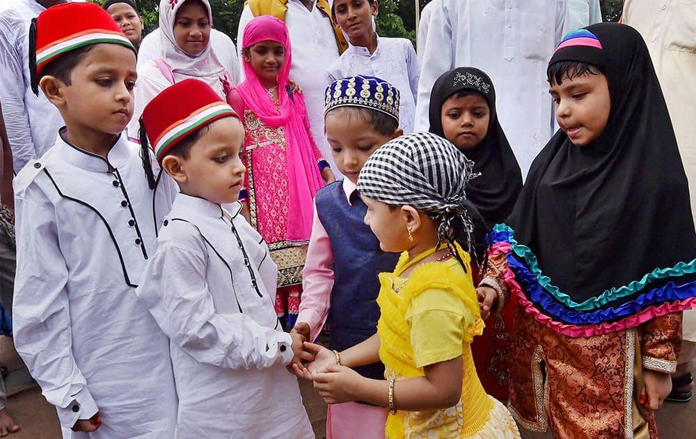 Muslims children celebrate Eid festival at Red road in Kolkata.