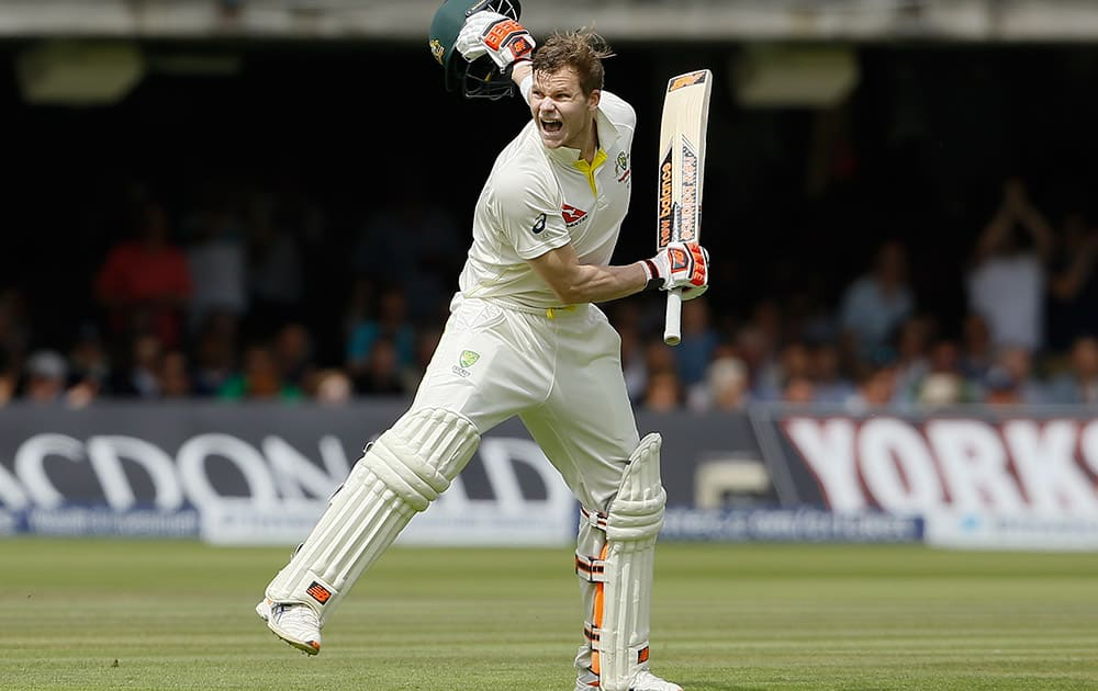 Australia's Steven Smith celebrates getting 200 runs on the second day of the second Ashes Test match between England and Australia, at Lord's cricket ground in London.
