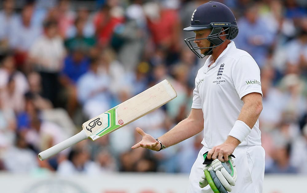 England's Ian Bell throws his bat as he leaves the pitch after being bowled by Australia's Josh Hazlewood on the second day of the second Ashes Test match between England and Australia, at Lord's cricket ground in London.