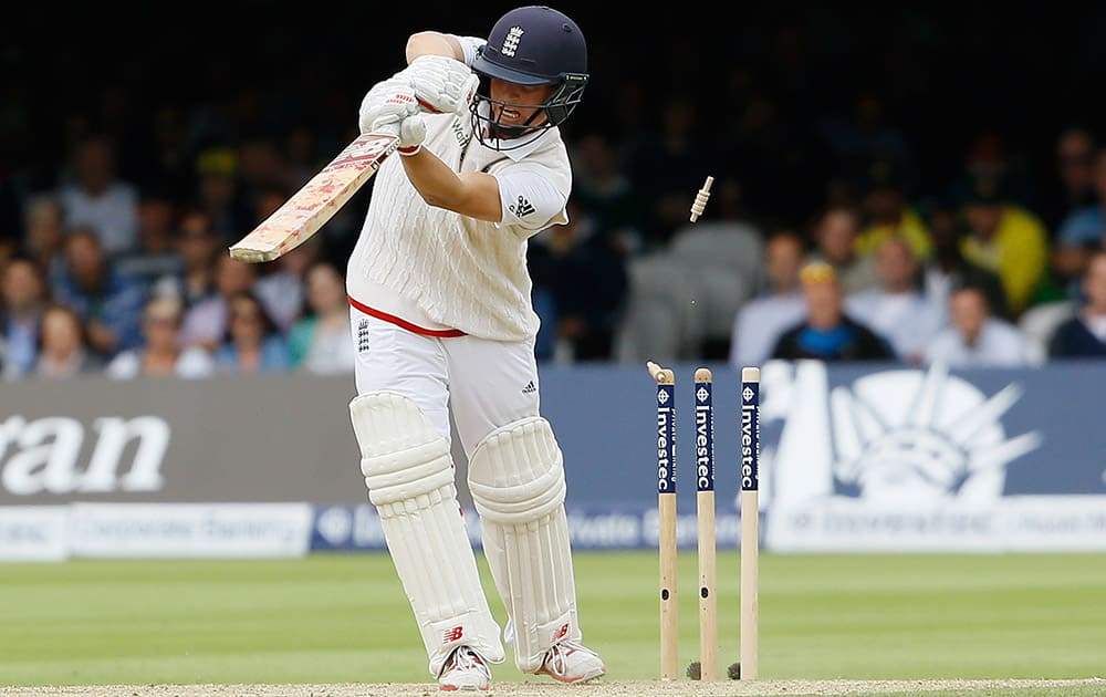 England's Gary Balance is bowled by Australia's Mitchell Johnson on the second day of the second Ashes Test match between England and Australia, at Lord's cricket ground in London.