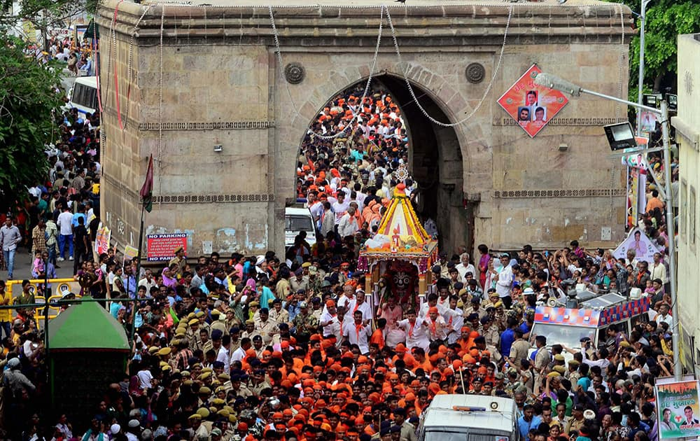 Devotees take part in 138th Rath Yatra of Lord Jagannath that passes through Jamal Gate in Ahmedabad.
