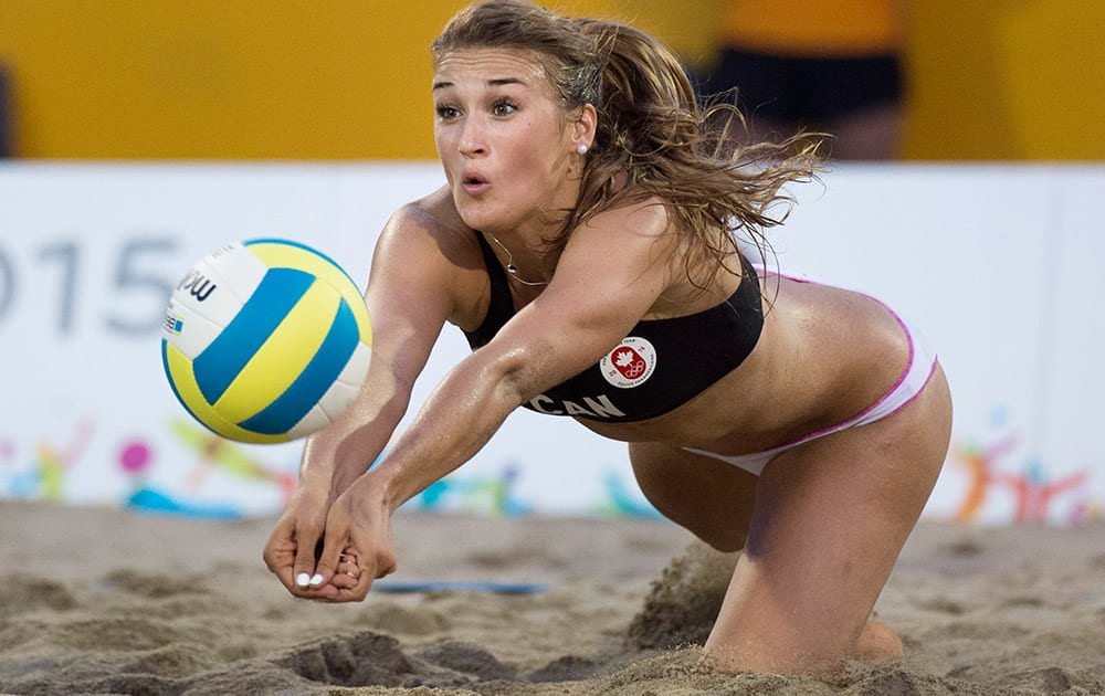 Taylor Pischke, of Canada, makes a dig during a quarter-final women's beach volleyball match against Costa Rica at the Pan Am Games in Toronto.