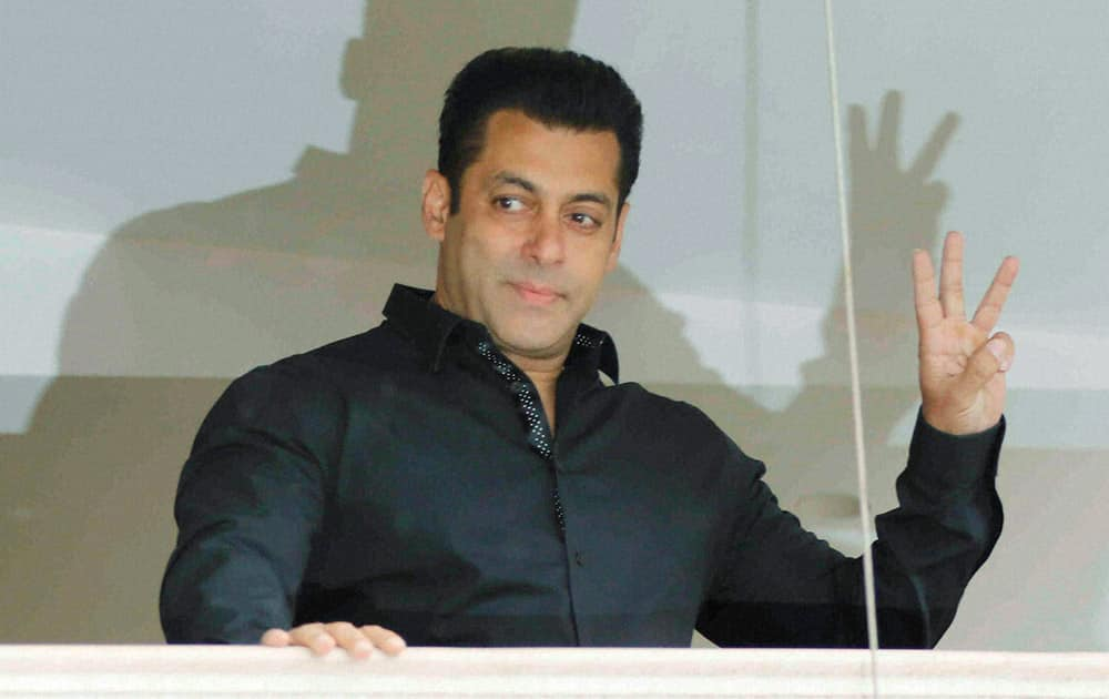 Salman Khan waves his fans during Eid al-Fitr celebrations in Mumbai.