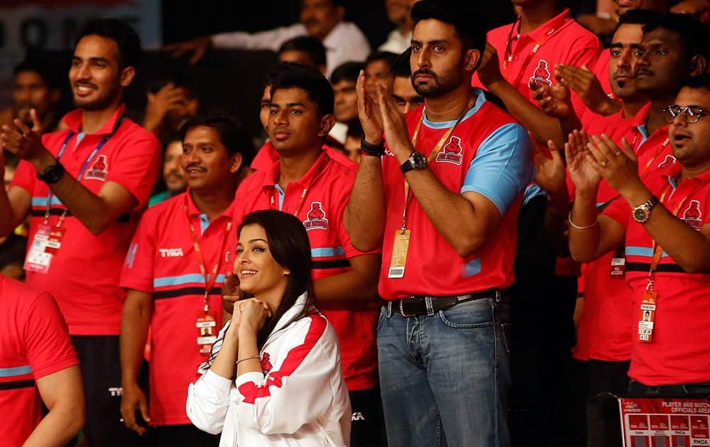 Abhishek Bachchan and his wife and actress Aishwarya Rai Bachchan watch the inaugural match of Pro-Kabaddi League 2015 between U Mumba and Jaipur Pink Panthers in Mumbai.