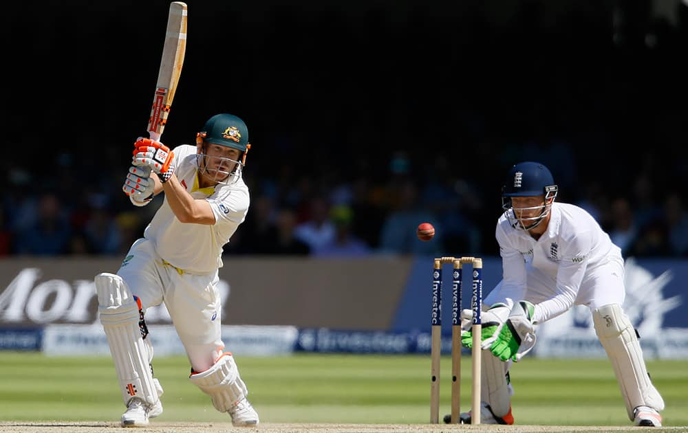 Australia's David Warner plays a shot off the bowling of England's Moeen Ali on the fourth day of the second Ashes Test match between England and Australia, at Lord's cricket ground in London.