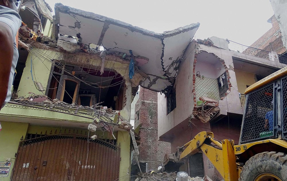 A four-storey building which collapses in the Vishnu Garden area of West Delhi.