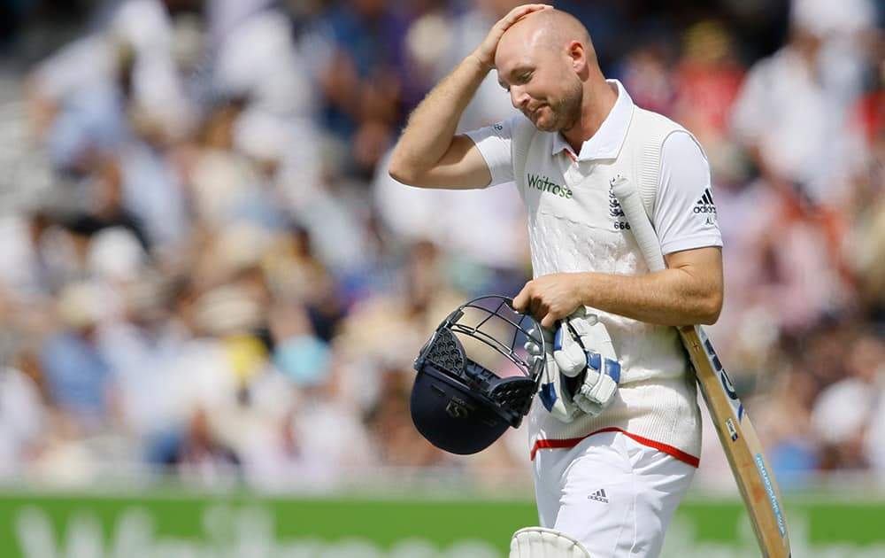 England's Adam Lyth leaves the pitch after being caught by Peter Nevill off the bowling of Australia's Mitchell Starc on the fourth day of the second Ashes Test match between England and Australia, at Lord's cricket ground in London.