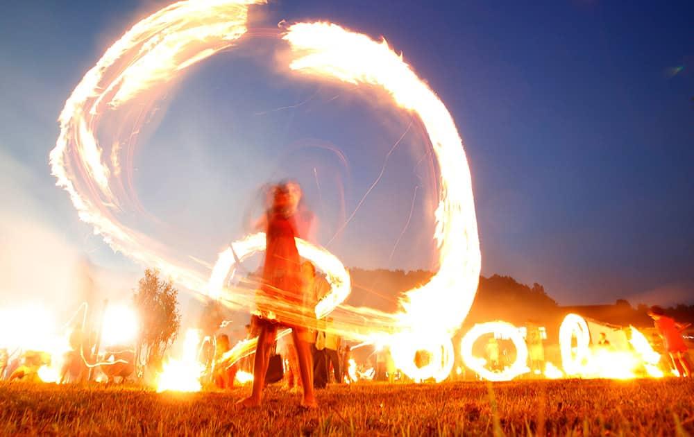 Bosnian children wave burning bark during celebrations of St. Ilija at the village Dokanj norheastern Bosnia, near Tuzla. Bosnian Catholics celebrate St.Ilija by burning the bark of cherry trees as part of tradition celebrating this holiday.