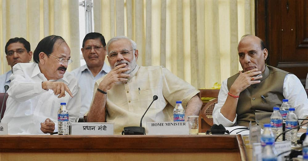 Prime Minister Narendra Modi with Home Minister Rajnath Singh and Parliamentary Affairs Minister M Venkaiah Naidu during the All Party Meeting at Parliament House in New Delhi.