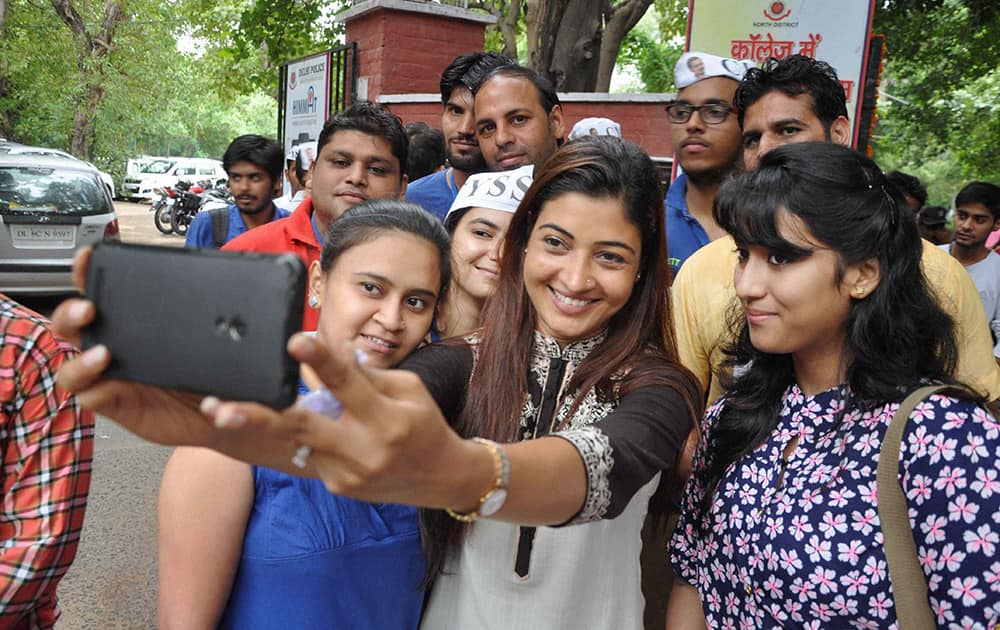 AAP MLA Alka Lamba taking selfie with fresher students at Ramjas College on the first day of the new academic session of Delhi University.