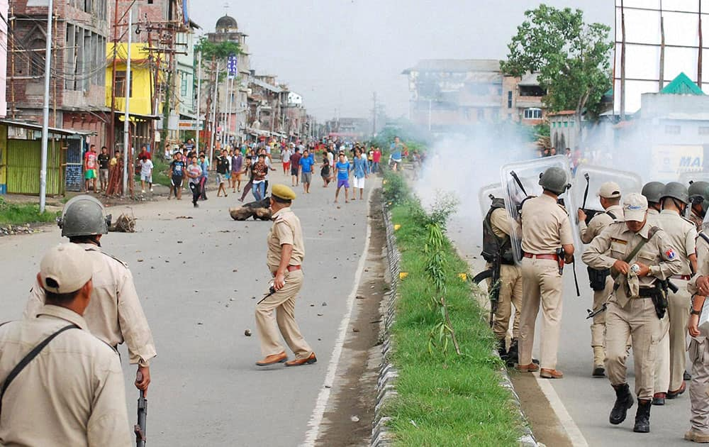 Police fire tear gas to disperse protesters at Tera, Imphal West on Monday demanding Inner Line Permit System in Manipur.
