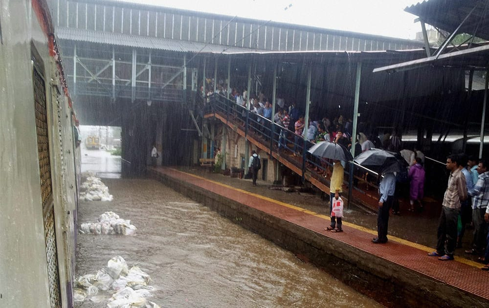 A view of waterlogged railway track at Sion station of CR after overnight incessant rains in Mumbai.