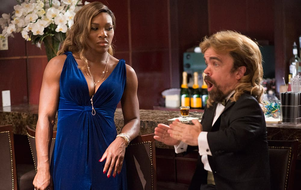This photo provided by courtesy of Sony Pictures shows, Serena Williams, as herself, on a date with Peter Dinklage as Eddie, in Columbia Pictures Pixels.