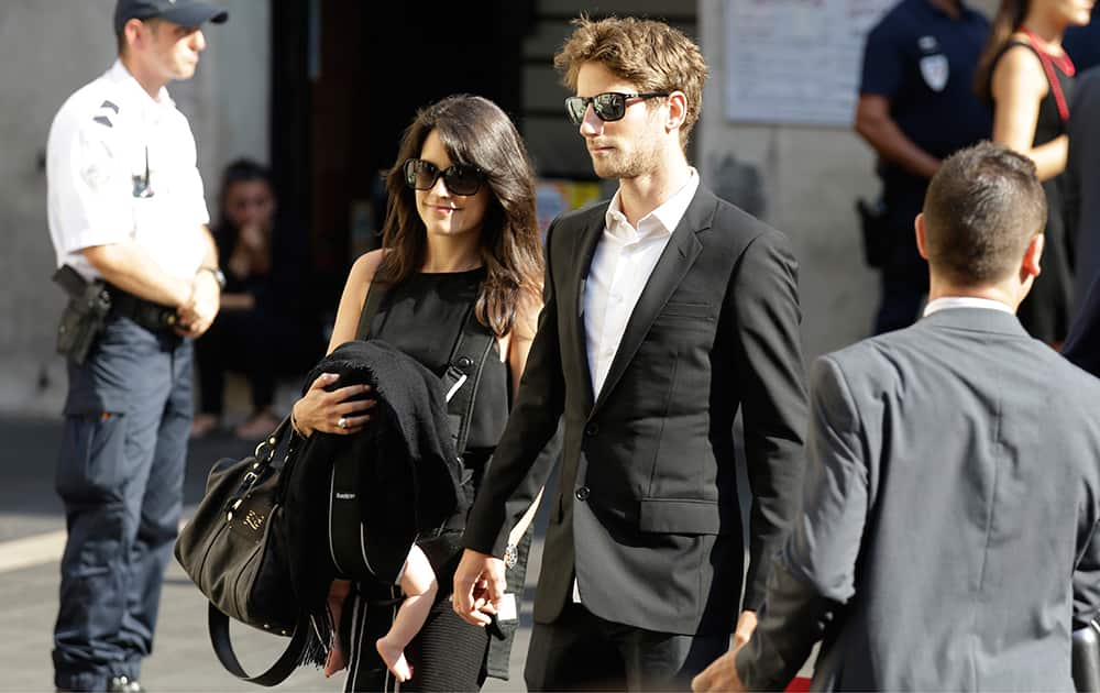 Lotus driver Romain Grosjean of France and Marion Jolles arrive at the Sainte Reparate Cathedral to attend the funeral of French Formula One driver Jules Bianchi in Nice, French Riviera.
