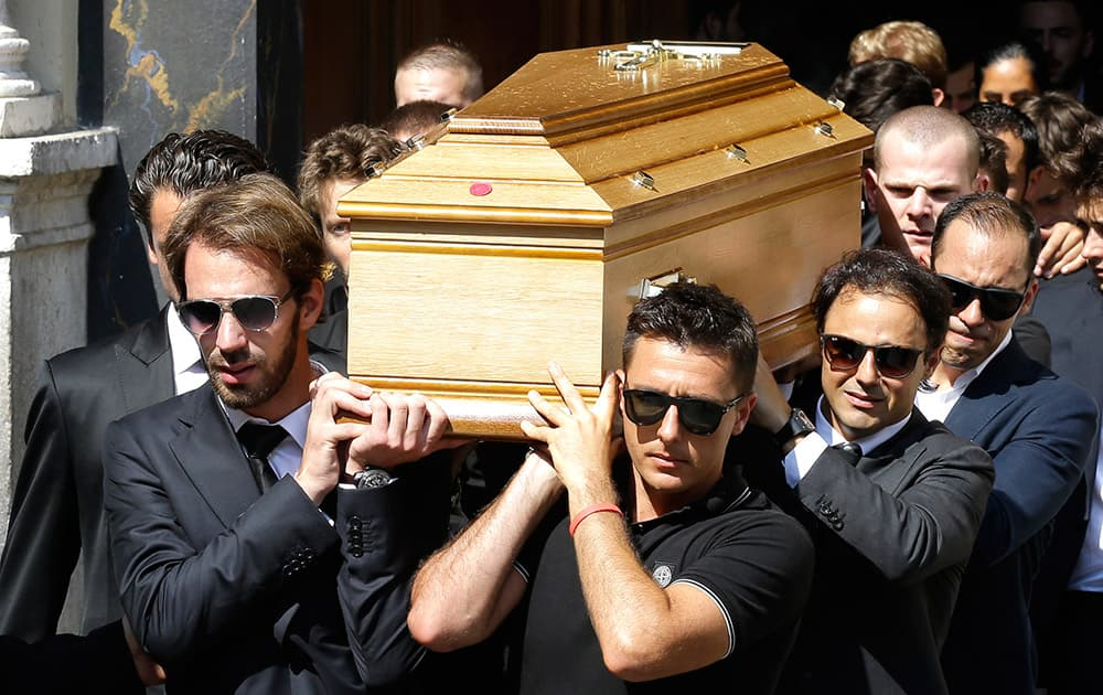 French Formula One driver Jean Eric Vergne, left, Brazilian Formula One driver Felipe Massa, second right, and Venezuelan Formula One driver Pastor Maldonado, right, carry the casket of French Formula One driver Jules Bianchi into Sainte Reparate Cathedral during his funeral in Nice, French Riviera.