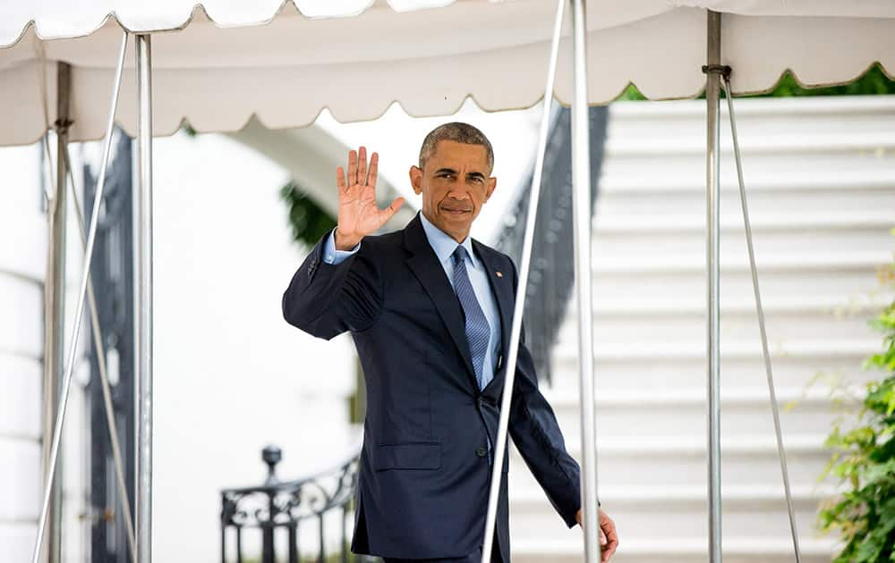 President Barack Obama waves to members of the media as he walks towards Marine One on the South Lawn at the White House in Washington, for a short trip to Andrews Air Force Base to travel to Pittsburgh where the President will address the 116th National Convention of the Veterans of Foreign Wars.