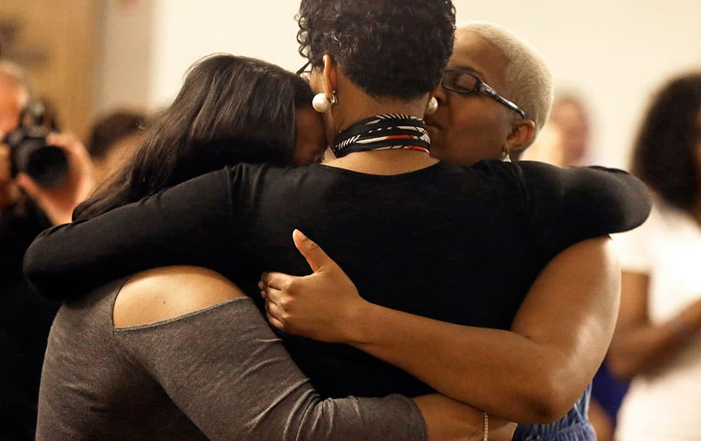 Geneva Read-Veal, center, hugs family members at a memorial service for her daughter Sandra Bland at Prairie View A&M University, in Prairie View, Texas.