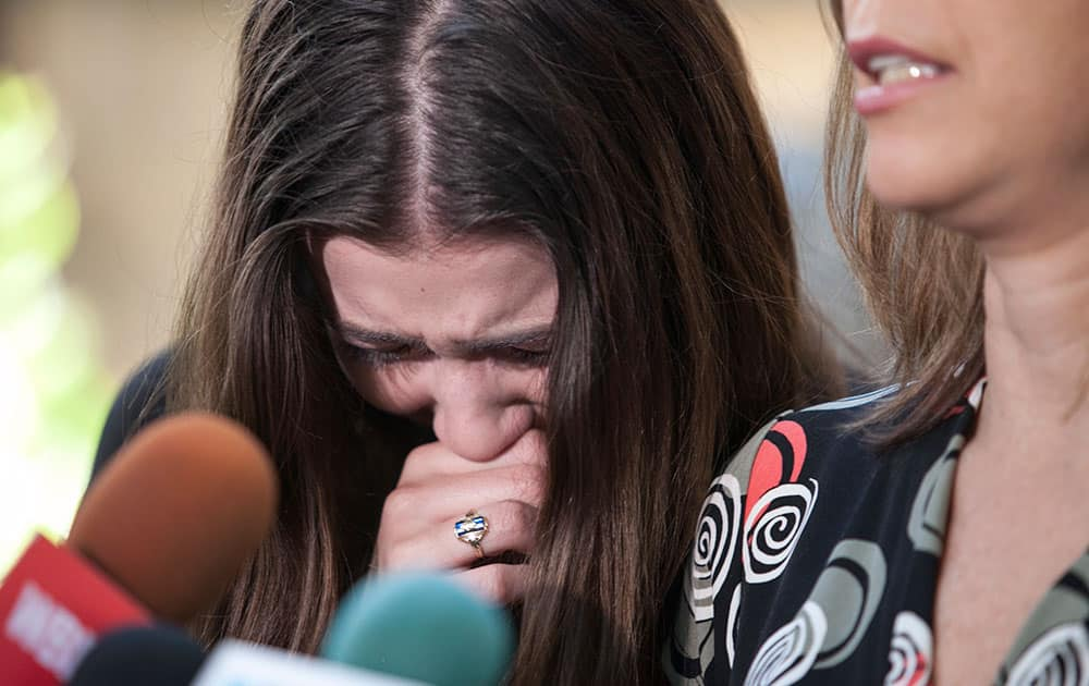 Amy Blagojevich, left, reacts as her mother, Patti Blagojevich, speaks during a news conference following the announcement of a federal appeals court regarding former Illinois Gov. Rod Blagojevic, in Chicago.