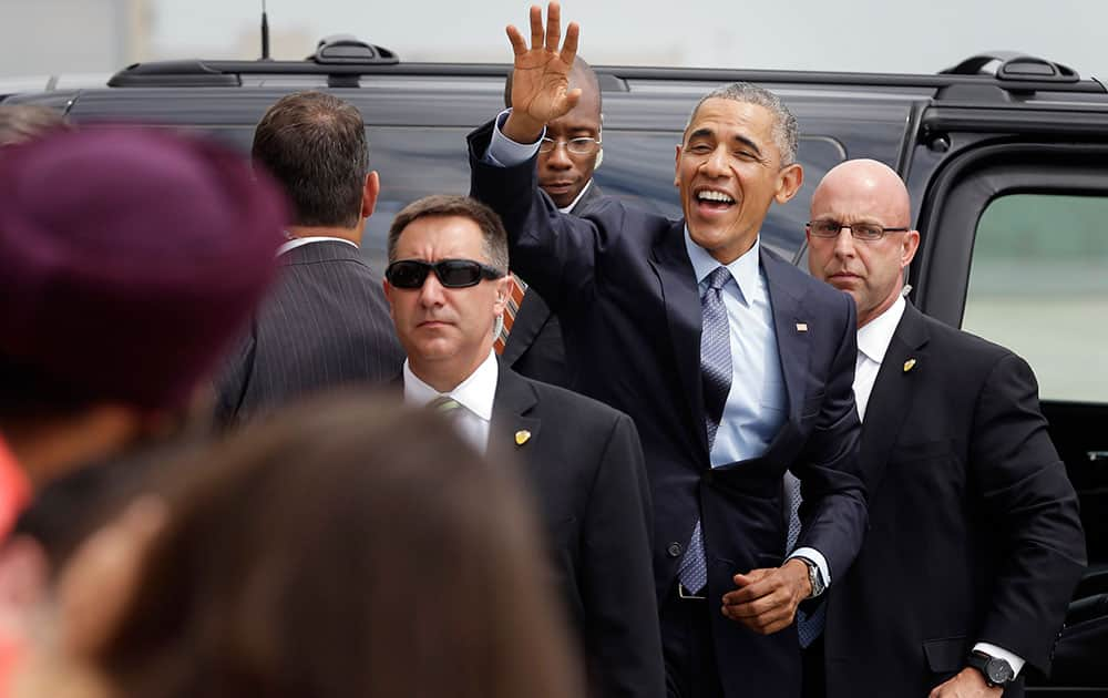 President Barack Obama waves to supporters as he leaves John. F. Kennedy airport in New York.