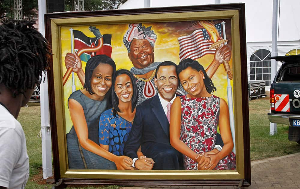 A painting depicting the Obama family and step-grandmother Sarah Obama above, stands outside an exhibition about the Global Entrepreneurship Summit which President Barack Obama will attend later in the week, in Nairobi, Kenya.