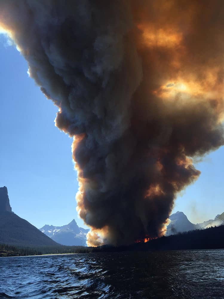 smoke from the Reynolds Creek fire rises above the landscape at St. Mary Lake in Glacier National Park, Mont. State Rep. Jenny Eck, who was hosting a delegation from Australia on a tour of the park, took this photo of the fast-moving wildfire.