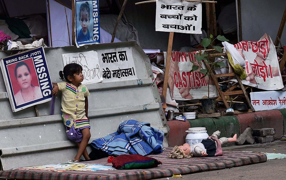 A girl child stands at the protest site near Jantar Mantar in New Delhi.