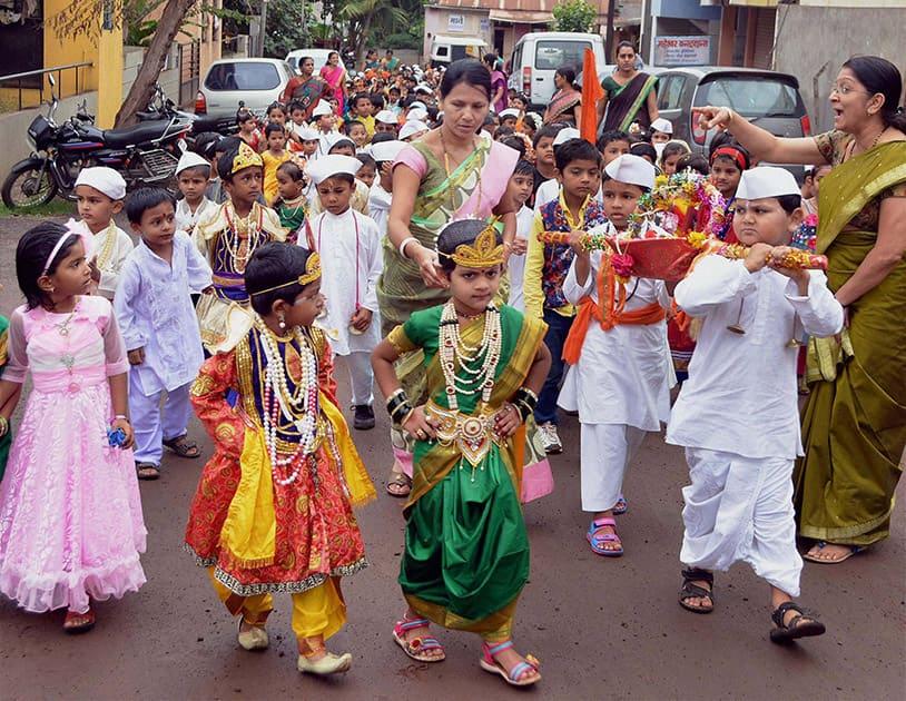 Children participate in the Dindi procession ahead of the Ashadhi Ekadashi in Karad, Maharashtra.