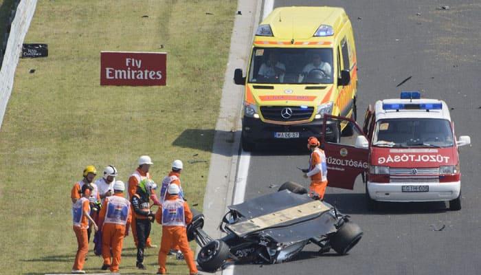 Sergio Perez unhurt after crash-landing upside down in Hungary