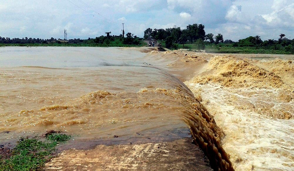 The National Highway 80 is washed out by flood waters after heavy rains at Nishindhapur in Murshidabad, West Bengal.