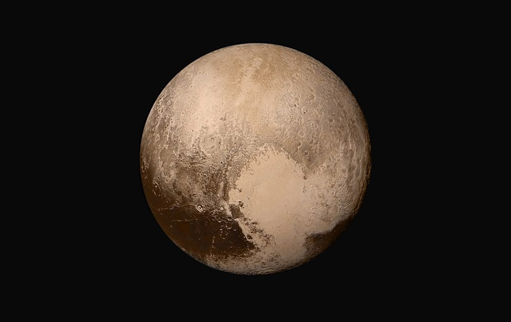 This image made available by NASA, shows Pluto made by combining several images from two cameras on the New Horizons spacecraft. The images were taken when the spacecraft was 280,000 miles (450,000 kilometers) away from Pluto.