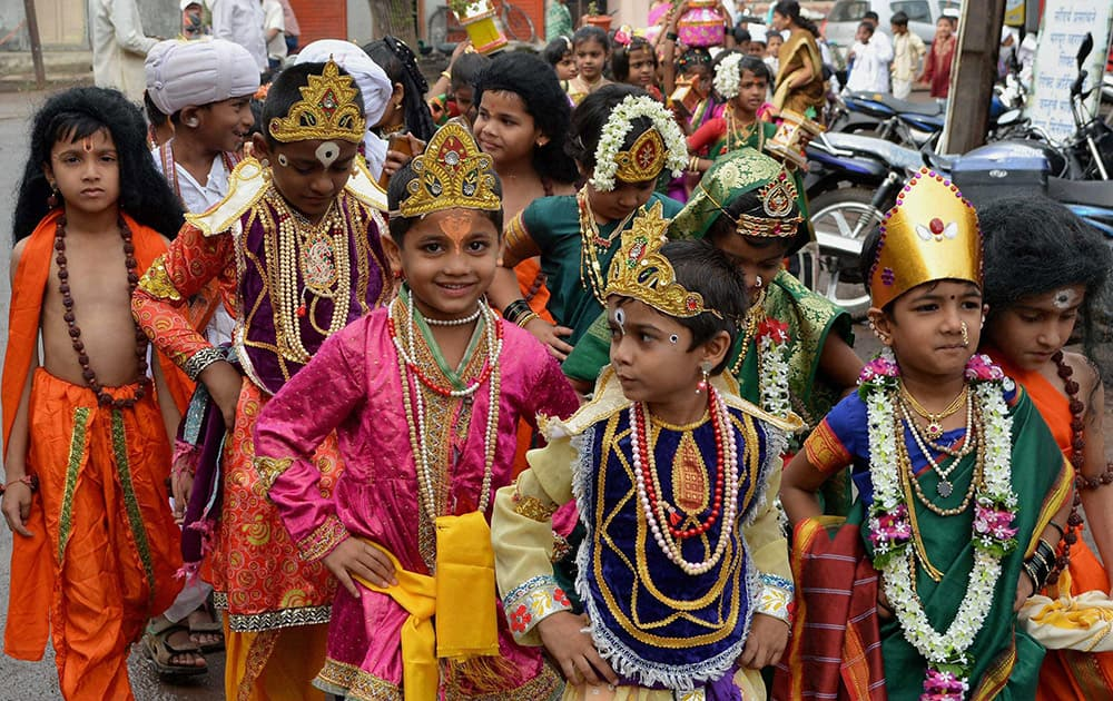 School children dressed up as Lord Vithal participate in the Palkhi procession ahead of the Ashadhi Ekadashi in Karad, Maharashtra.