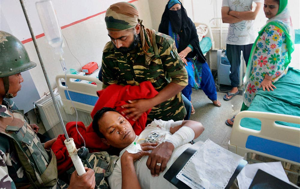 An injured CRPF jawan being treated at a Local hospital in Anantnag on Saturday after a grenade attack by the militants.
