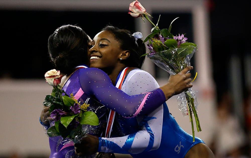 Simone Biles, right, hugs Gabby Douglas, left, after the Secret U.S. Classic gymnastics competition in Hoffman Estates, Ill.
