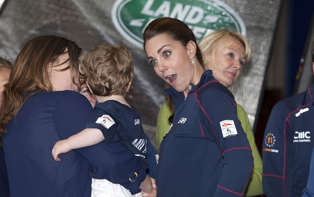 Kate, the Duchess of Cambridge, centre, accompanied by Britain's Prince William, meets family members on a visit to the new BAR, Ben Ainslie Racing team base for the America's Cup World Series, in Portsmouth, England.