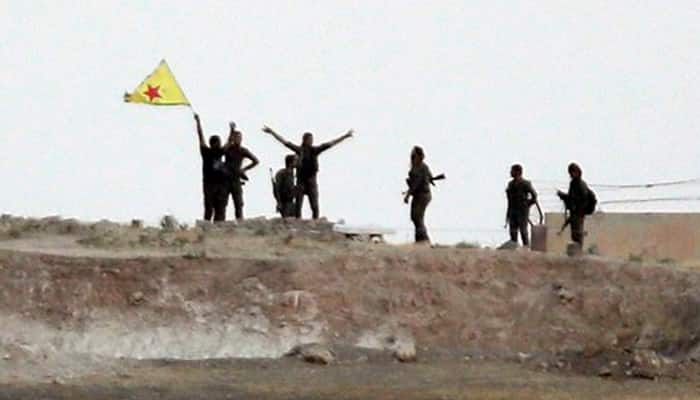 Syrian Kurds capture town from Islamic State in north-monitor