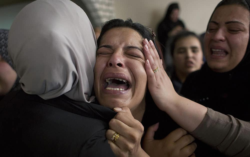 Aisha Abu Latifeh, a cousin of Palestinian Mohammed Lafi Abu Latifeh, 20, who was killed during an Israeli arrest raid, cries at the family house during his funeral procession in the Qalandia refugee camp on the outskirts of the West Bank city of Ramallah.