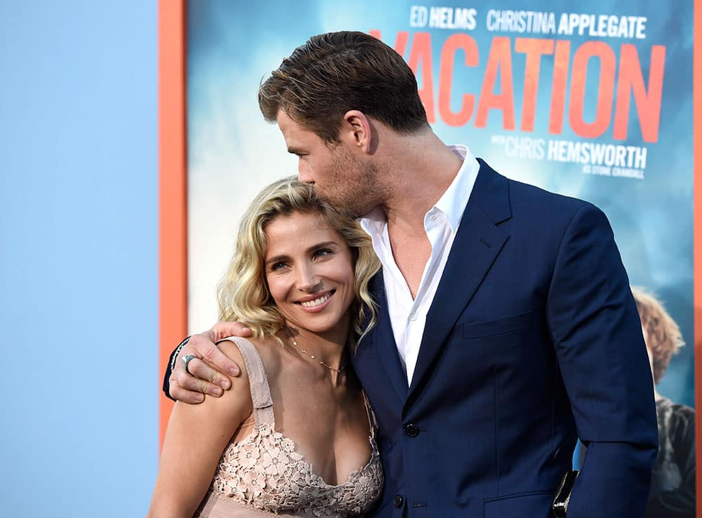 Elsa Pataky, left, and Chris Hemsworth arrive at the Los Angeles premiere of