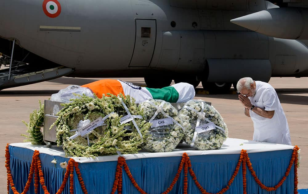 Prime Minister Narendra Modi pays respect after the body of former President A.P.J. Abdul Kalam arrived at the Palam airport in New Delhi, India.